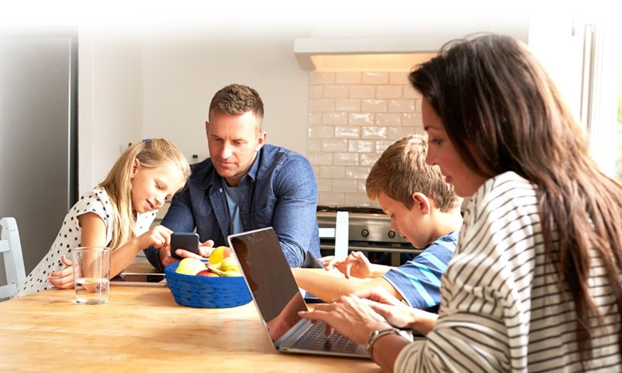 Family using various devices together